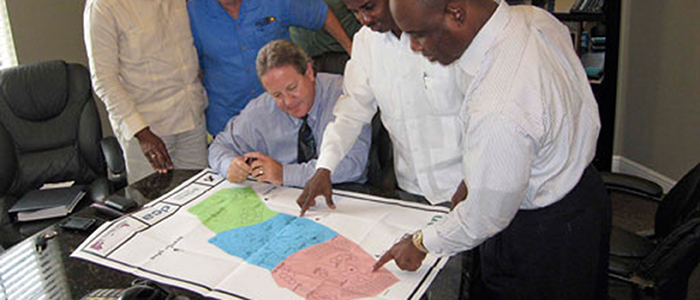 HACBED CFO, Sedrick Celestin, with the Mayor of Delmas working city project plans